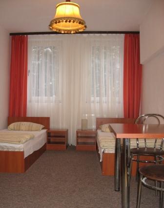Noclegi tanie Olsztyn hotel pokoje z łazienkami TV, WiFi i parking gratis.